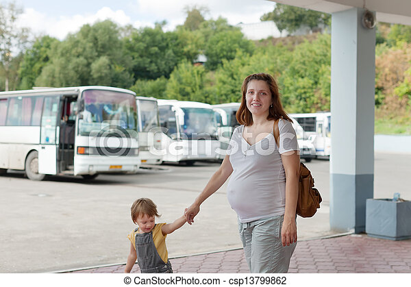 Family at bus station - csp13799862