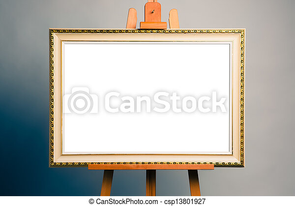 easel with antique painting frame - csp13801927