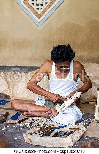 A man is making wooden crafts