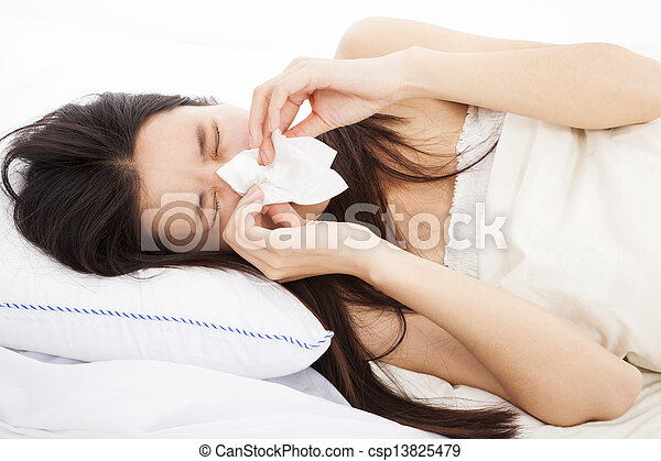 young Woman with flu and laying in bed - csp13825479