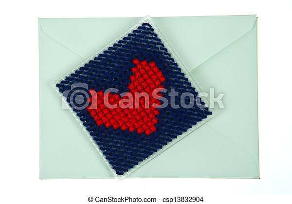 Green envelop with red knitted heart isolated on white background - csp13832904