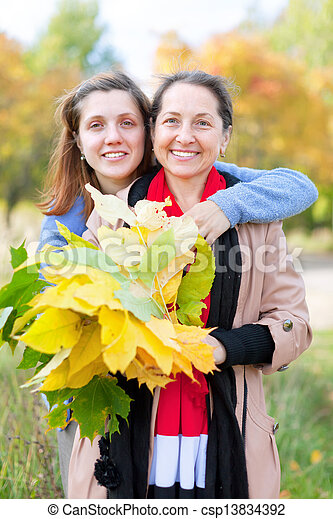happy women in autumn    - csp13834392
