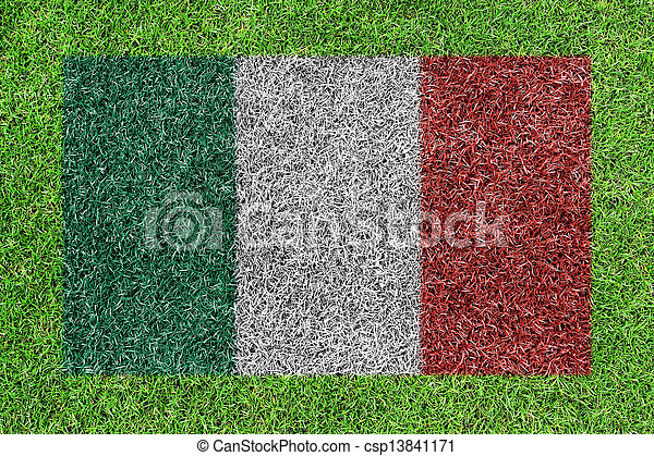 a flag of italy as painting on green grass background