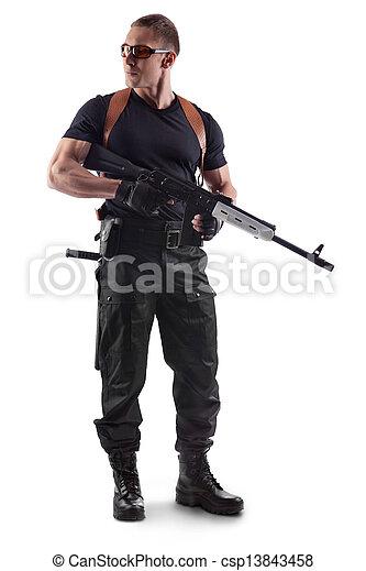 Police officer is holding Kalashnikov - csp13843458