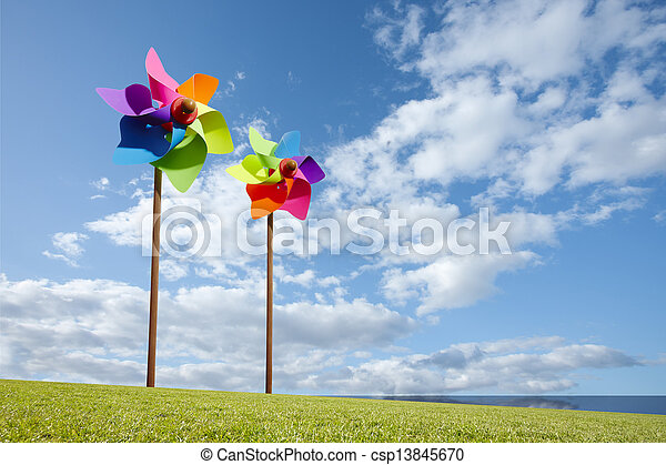 Toy windmill concept of green energy wind farm by the sea - csp13845670