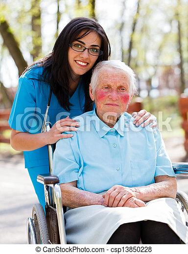 Doctor, Nurse With Elderly Patient - csp13850228