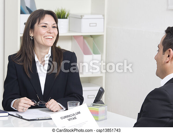 man explaining about her profile to business managers at a job interview - csp13851743