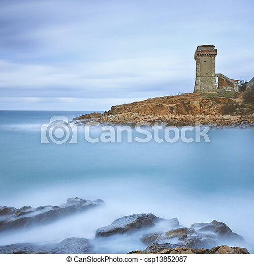 Calafuria Tower landmark on cliff rock and sea. Tuscany, Italy. Long exposure photography. - csp13852087