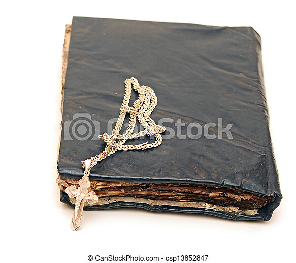 Religion. A cross with a chain against a old book - csp13852847