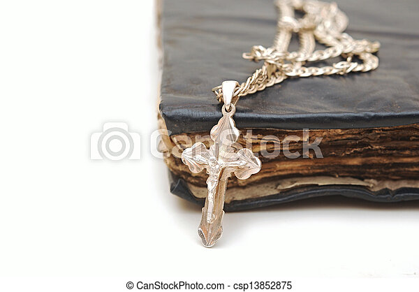 Religion. A cross with a chain against a old book - csp13852875