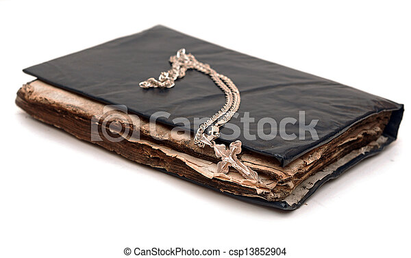 Religion. A cross with a chain against a old book - csp13852904