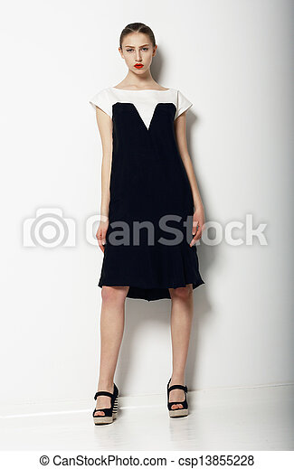 Full Portrait of Elegant Refined Female in Urban Black - White  Dress. Fashion - csp13855228