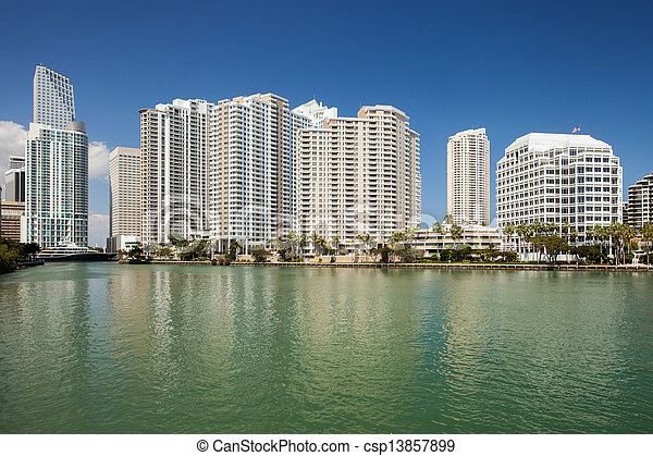 Miami city Florida, USA, view of downtown financial buildings and Brickell key on a summer day with blue sky - csp13857899