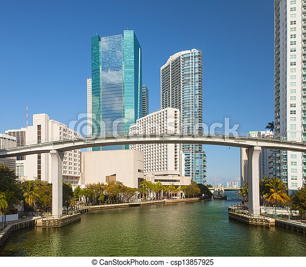 Miami Florida, Brickell and downtown financial buildings and train bridge over miami River on a beautiful summer day with blue sky - csp13857925