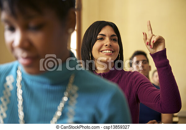 People at school, student raising hand and asking question to professor during class in college, Law School, University of Havana, Cuba - csp13859327