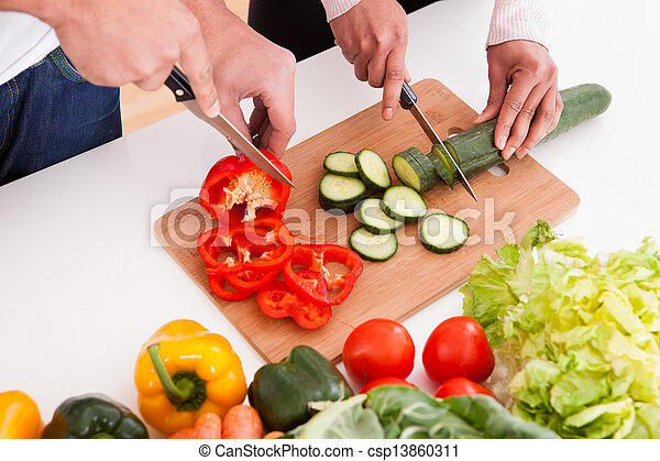 Couple Chopping Vegetables - csp13860311