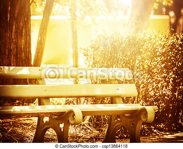 Wooden bench in the park - csp13864118