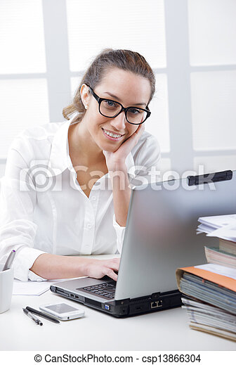 Business woman portrait in an office - csp13866304