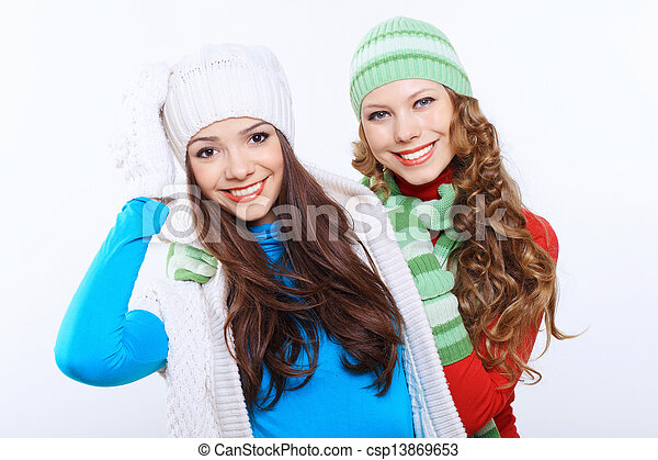 Young woman wearing winter hat and warm scarf - csp13869653