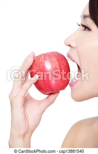 young woman eating red apple with health teeth - csp13881540