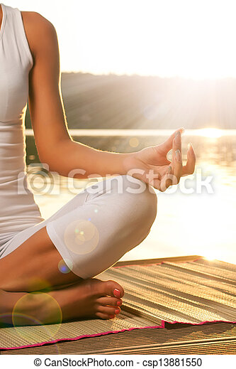 Young woman relaxing on the beach - csp13881550