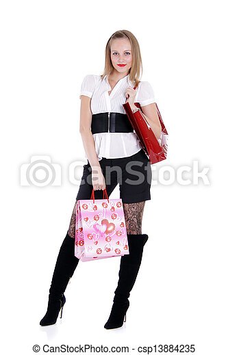 Happy young adult woman with colored bags - csp13884235