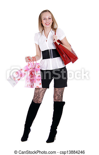 Happy young adult woman with colored bags - csp13884246