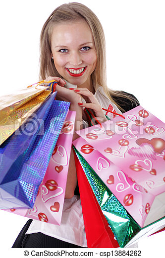 Happy young adult woman with colored bags  - csp13884262