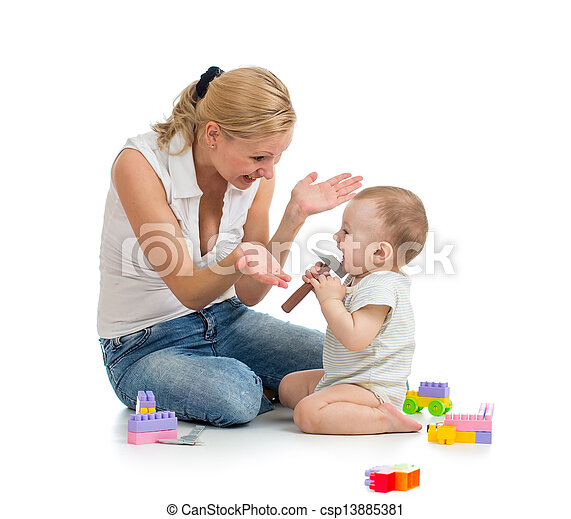 baby boy and mother playing together with construction set toy - csp13885381