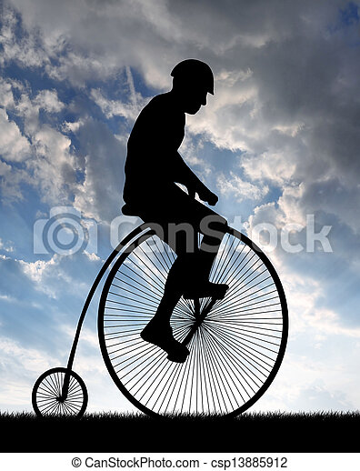 cyclist on historic bicycle - csp13885912