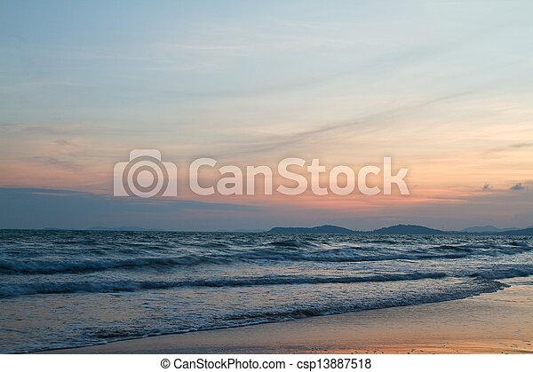 Tropical beach at beautiful sunset. Nature background   - csp13887518