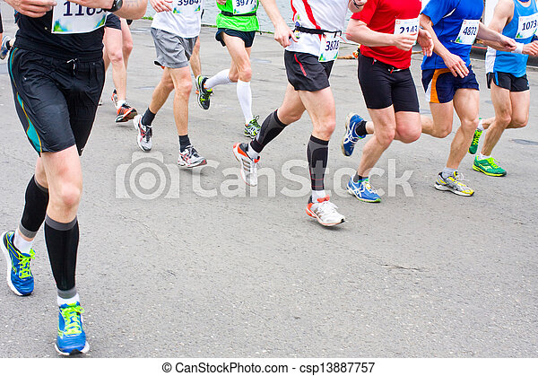 detail of the legs of runners at the start of a marathon race  - csp13887757