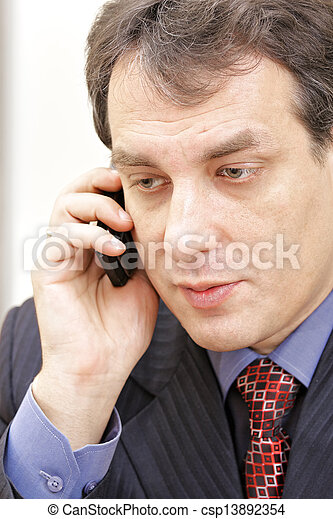 Middle aged businessman on phone