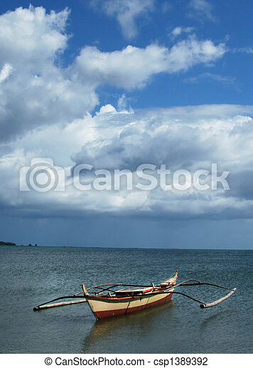 Fishing boat during low tide - csp1389392