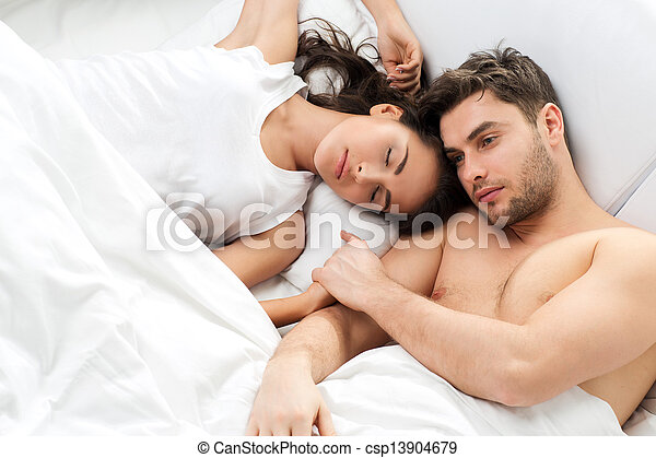 Young adult couple in bedroom - csp13904679