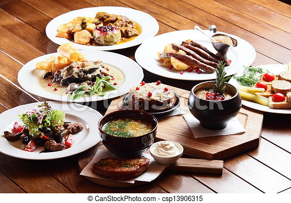 dishes with different food - csp13906315