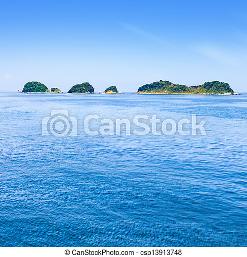 Small islands on sea and blue sky. Toba bay, Japan. - csp13913748