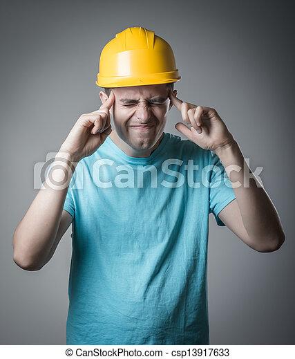 worker in helmet headache