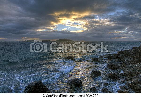 Clear sky opens through dark storm clouds over tropical Caribbean island of Culebrita