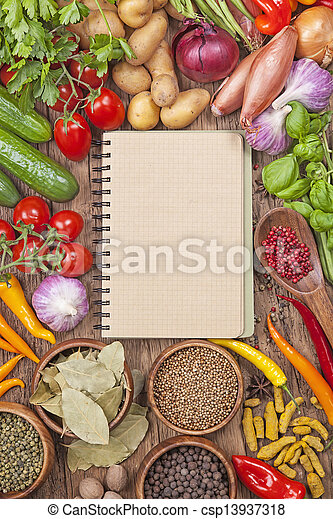 Assortment of fresh vegetables and blank recipe book - csp13937318