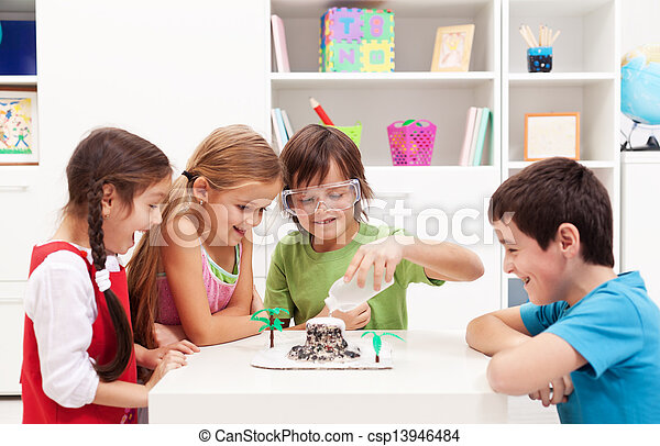 Kids observing a science lab project at home - csp13946484