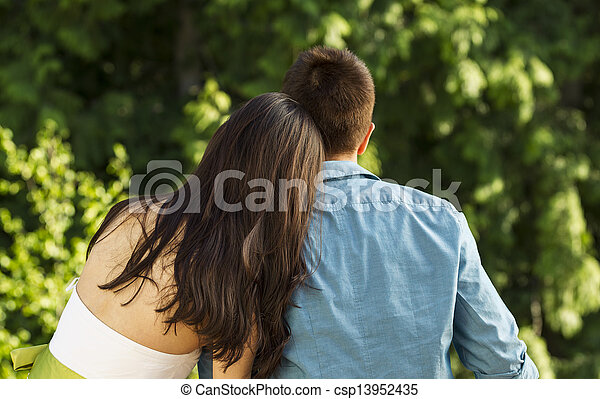 Young Adult Couple enjoying the view of nature - csp13952435