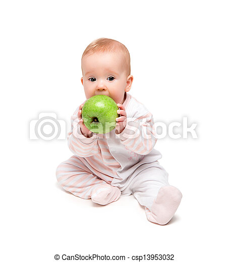 cute happy baby eats fruit green apple isolated - csp13953032
