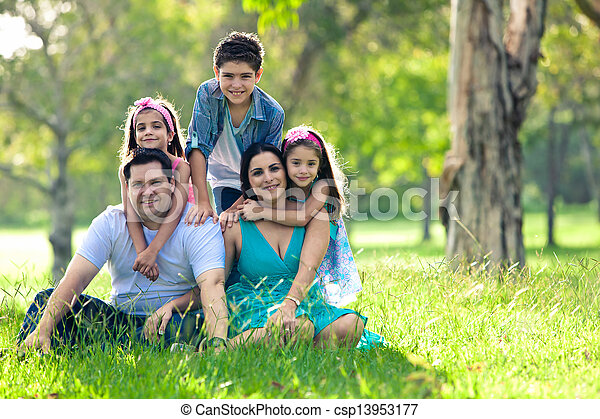 Happy family having fun outdoors in spring park - csp13953177