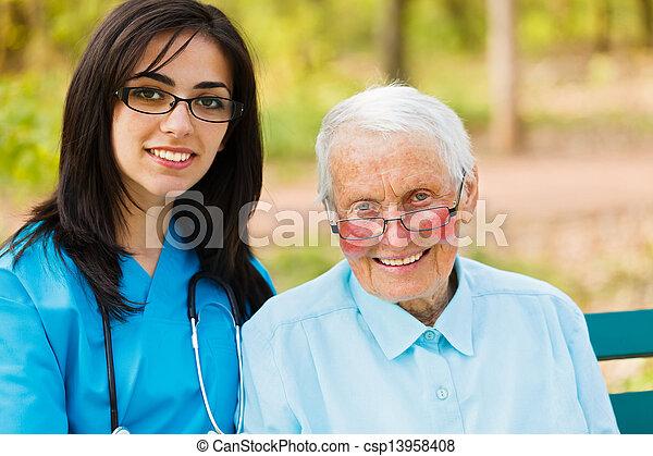 Portrait of Nurse and Elderly Patient - csp13958408