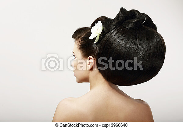 Haircare. Backside of Fashion Model with Creative Hairstyle. Smooth Healthy Black Hair with Flower. Spa Salon - csp13960640