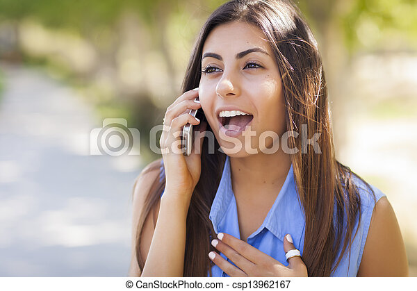 Mixed Race Young Adult Woman Using Her Cell Phone - csp13962167