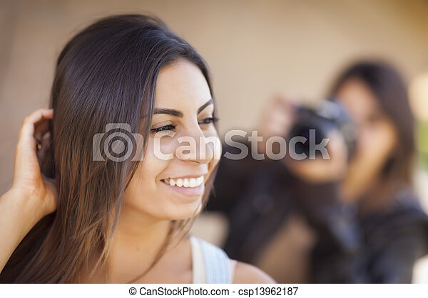 Young Adult Mixed Race Female Model Poses for Photographer - csp13962187