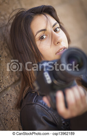 Mixed Race Young Adult Female Photographer Holding Camera - csp13962189