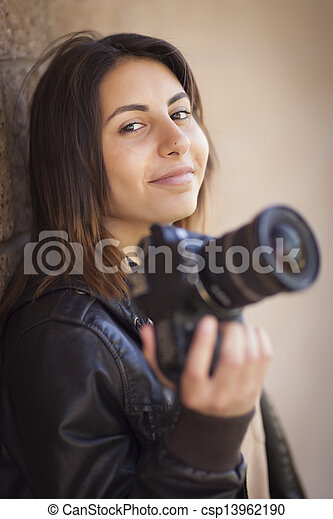 Mixed Race Young Adult Female Photographer Holding Camera - csp13962190